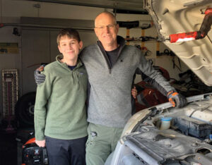 Father and Son work on cars